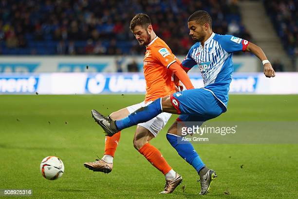 Marcel Heller of Darmstadt is challenged by Jeremy Toljan of Hoffenheim during the Bundesliga match between 1899 Hoffenheim and SV Darmstadt 98 at...
