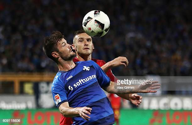 Marcel Heller of Darmstadt is challenged by Pavel Kaderabek of Hoffenheim during the Bundesliga match between SV Darmstadt 98 and TSG 1899 Hoffenheim...