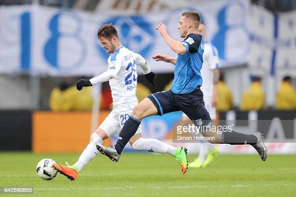 Marcel Heller of Darmstadt is challenged by Pavel Kaderabek of Hoffenheim during the Bundesliga match between TSG 1899 Hoffenheim and SV Darmstadt 98...