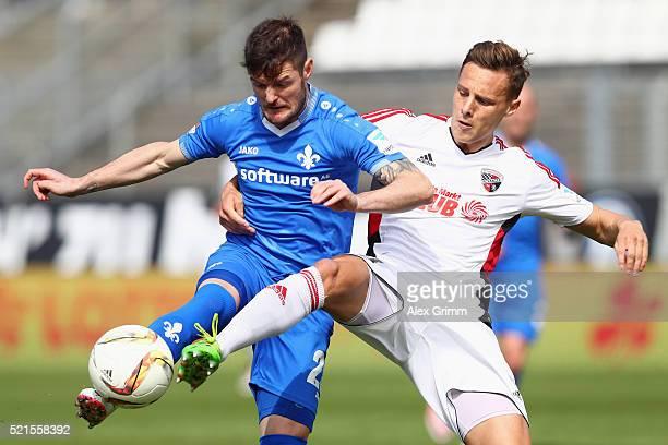 Marcel Heller of Darmstadt is challenged by Robert Bauer of Ingolstadt during the Bundesliga match between SV Darmstadt 98 and FC Ingolstadt at...