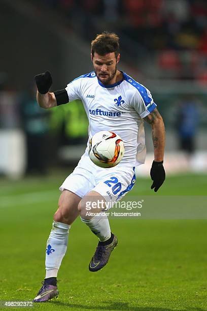 Marcel Heller of Darmstadt runs with the ball during the Bundesliga match between FC Ingolstadt and SV Darmstadt 98 at Audi Sportpark on November 22...
