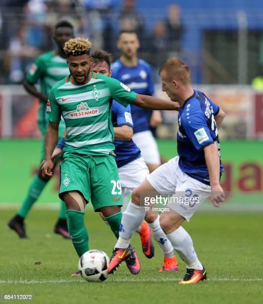 Marcel Heller of Darmstadt Serge Gnabry of Bremen and Laszlo Kleinheisler of Darmstadt battle for the ball during the Bundesliga match between SV...