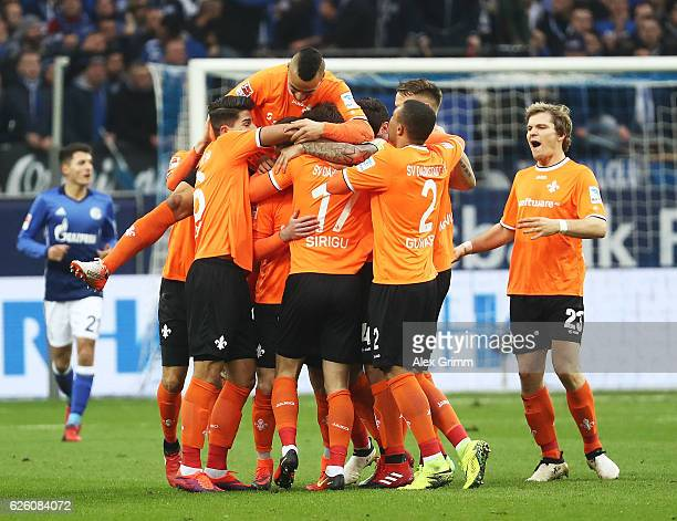 Marcel Heller of SV Darmstadt 98 is crongratulated after scoring the first goal during the Bundesliga match between FC Schalke 04 and SV Darmstadt 98...