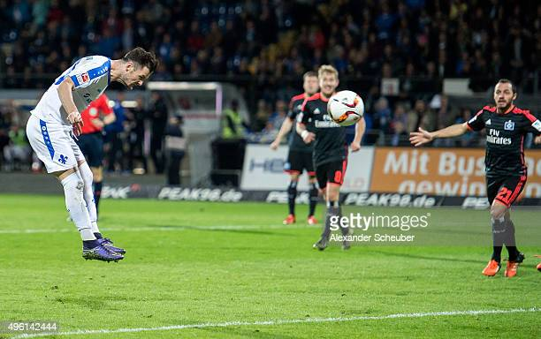 Marcel Heller of SV Darmstadt 98 scores the first goal for his team during the first bundesliga match between SV Darmstadt 98 and Hamburger SV at...