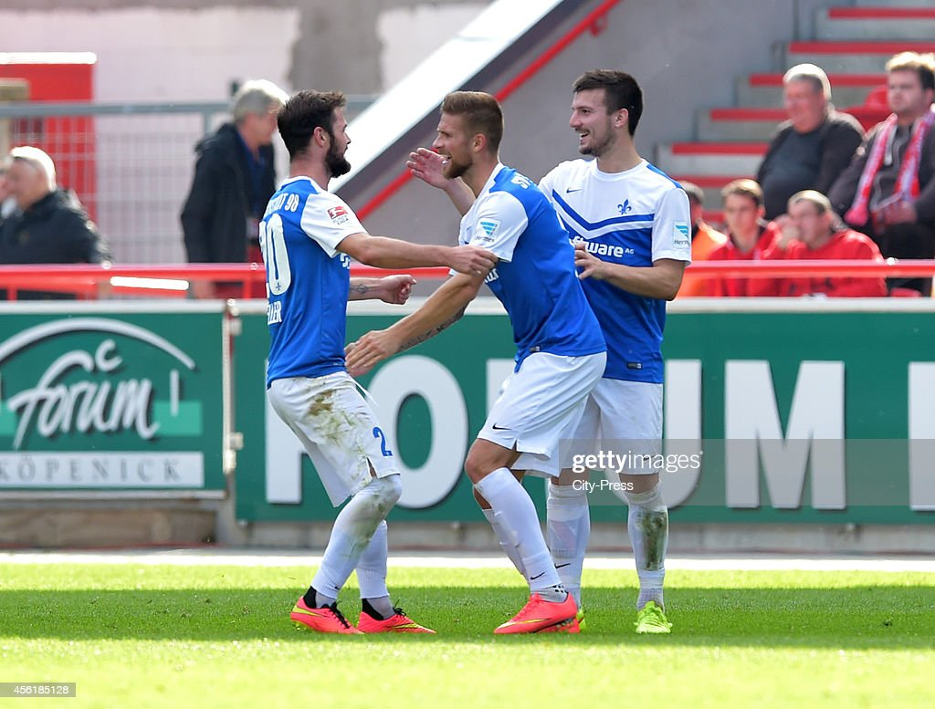 Marcel Heller Tobias Kempe and Jerome Gondorf of SV Darmstadt 98 celebrate after scoring the 01 during the game between 1 FC Union Berlin and SV...