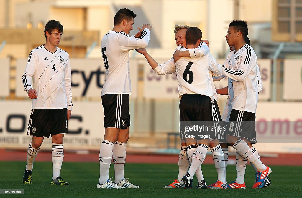 Marcel Hilssner (3rd L) of Germany celebrates his team's first goal with his team mates during the international friendly match between U18 Cyprus and U18 Germany at Stadio Tasos Markou on February 5, 2013 in Paralimni, Cyprus.