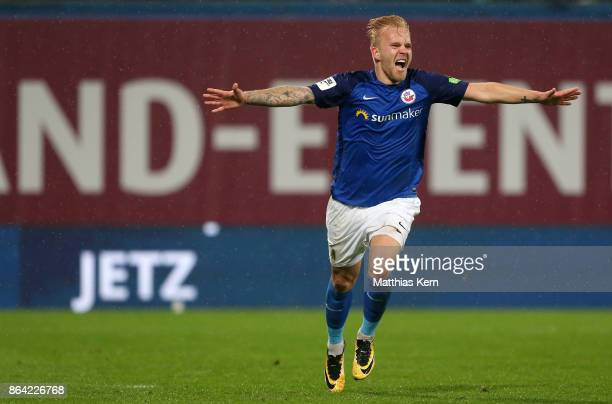 Marcel Hilssner of Rostock jubilates after scoring the second goal during the third league match between FC Hansa Rostock and VfL Osnabrueck at...