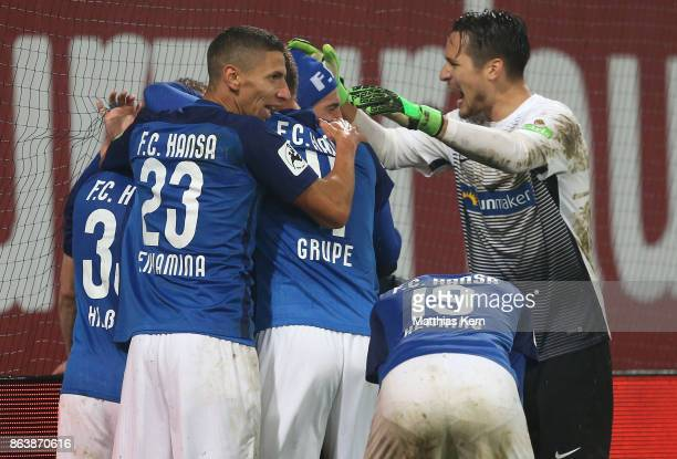 Marcel Hilssner of Rostock jubilates with team mates after scoring the second goal during the third league match between FC Hansa Rostock and VfL...