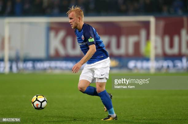 Marcel Hilssner of Rostock runs with the ball during the third league match between FC Hansa Rostock and VfL Osnabrueck at Ostseestadion on October...