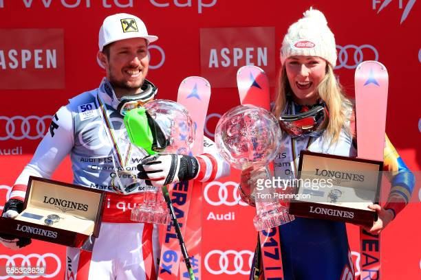 Marcel Hirscher of Austria and Mikaela Shiffrin of United States celebrates with the globes for being awarded the overall season men's and ladies'...
