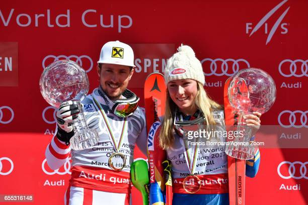 Marcel Hirscher of Austria and Mikaela Shiffrin of USA win the globe in the overall standings during the Audi FIS Alpine Ski World Cup Finals Women's...