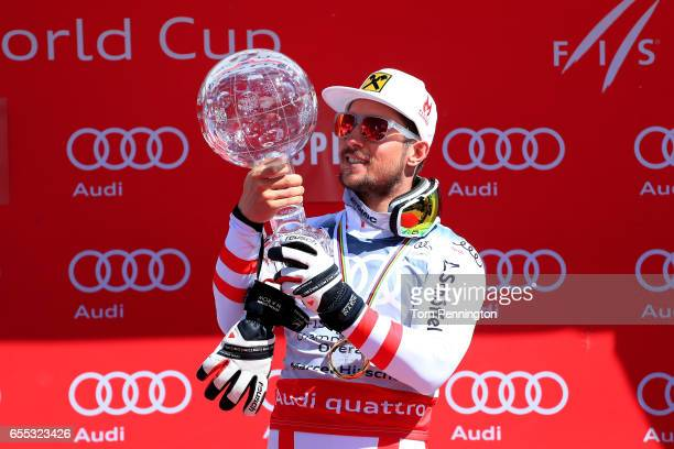 Marcel Hirscher of Austria celebrates with the globe for being awarded the overall season men's champion at the 2017 Audi FIS Ski World Cup Finals at...