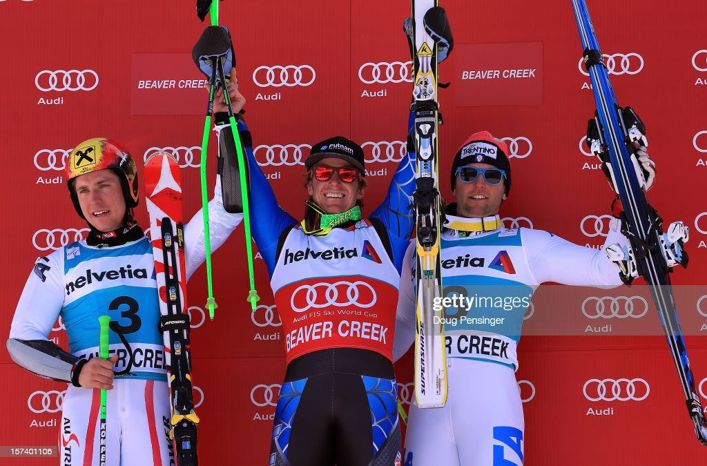Marcel Hirscher of Austria in second place,Ted Ligety of the USA in first place and Davide Simoncelli of Italy in third place take the podium for the men's Giant Slalom at the Audi FIS World Cup on December 2, 2012 in Beaver Creek, Colorado.