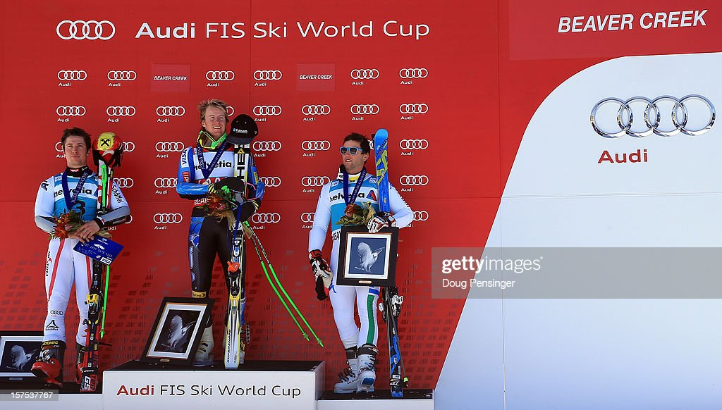 <a gi-track='captionPersonalityLinkClicked' href=/galleries/search?phrase=Marcel+Hirscher&family=editorial&specificpeople=4784559 ng-click='$event.stopPropagation()'>Marcel Hirscher</a> of Austria in second place,<a gi-track='captionPersonalityLinkClicked' href=/galleries/search?phrase=Ted+Ligety&family=editorial&specificpeople=580537 ng-click='$event.stopPropagation()'>Ted Ligety</a> of the USA in first place and <a gi-track='captionPersonalityLinkClicked' href=/galleries/search?phrase=Davide+Simoncelli&family=editorial&specificpeople=247211 ng-click='$event.stopPropagation()'>Davide Simoncelli</a> of Italy in third place take the podium for the men's Giant Slalom at the Audi FIS World Cup on December 2, 2012 in Beaver Creek, Colorado.
