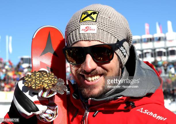 Marcel Hirscher of Austria poses with his gold and silver medals after winning the Men's Slalom during the FIS Alpine World Ski Championships on...