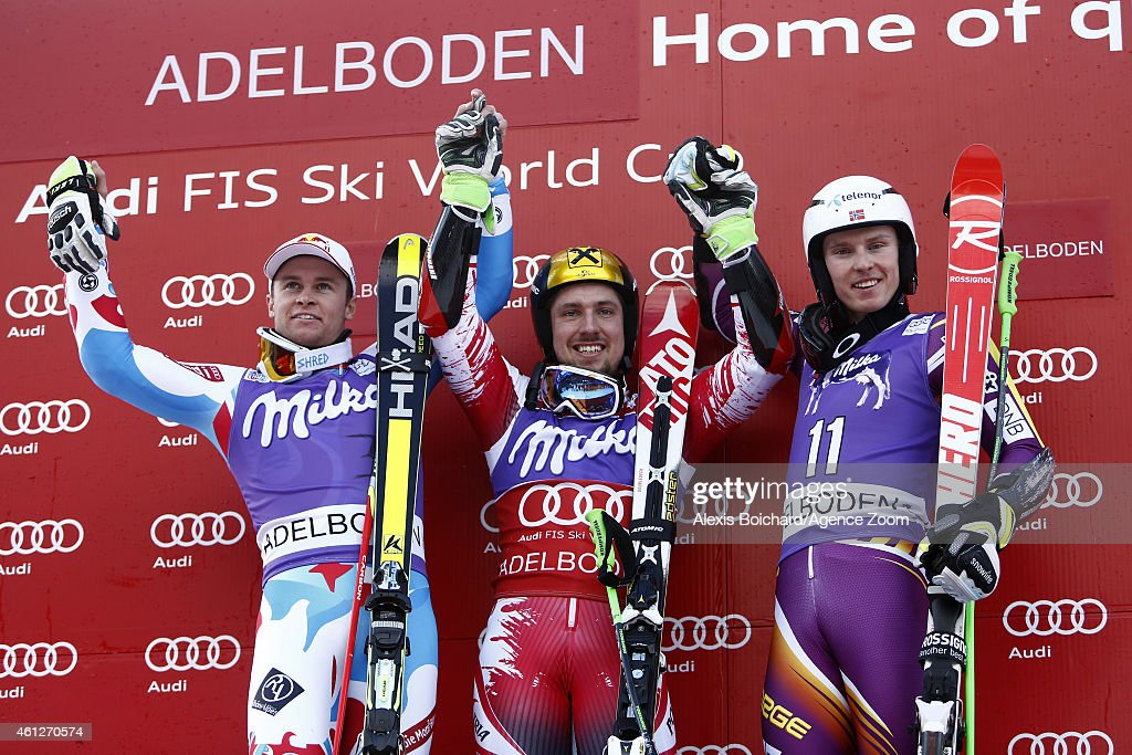 Marcel Hirscher of Austria takes 1st place (C), Alexis Pinturault of France takes 2nd place (L) and Henrik Kristoffersen of Norway takes 3rd place (R) during the Audi FIS Alpine Ski World Cup Men's Giant Slalom on January 10, 2015 in Adelboden, Switzerland.