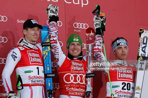 Marcel Hirscher of Austria takes 1st place Hannes Reichelt of Austria takes 2nd place Marcel Mathis of Austria takes 3rd place during the Audi FIS...
