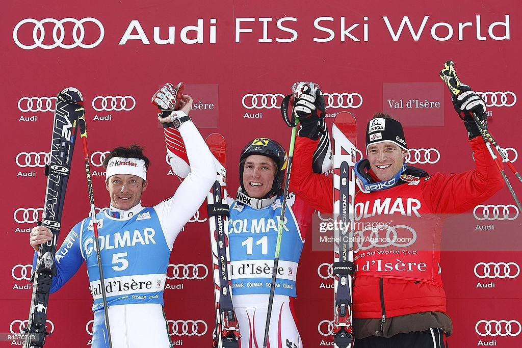 Marcel Hirscher of Austria takes 1st place, <a gi-track='captionPersonalityLinkClicked' href=/galleries/search?phrase=Massimiliano+Blardone&family=editorial&specificpeople=776052 ng-click='$event.stopPropagation()'>Massimiliano Blardone</a> of Italy takes 2nd place, <a gi-track='captionPersonalityLinkClicked' href=/galleries/search?phrase=Benjamin+Raich&family=editorial&specificpeople=209244 ng-click='$event.stopPropagation()'>Benjamin Raich</a> of Austria takes 3rd place during the Audi FIS Alpine Ski World Cup Men's Giant Slalom on December 13, 2009 in Val d'Isere, France.