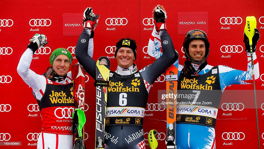Marcel Hirscher of Austria takes 2nd place, Ivica Kostelic of Croatia takes 1st place, Mario Matt of Austria takes 3rd place during the Audi FIS Alpine Ski World Cup Men's Slalom on March 10, 2013 in Kranjska Gora, Slovenia.