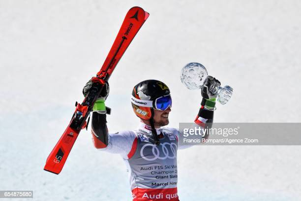 Marcel Hirscher of Austria wins the globe in the overall standings during the Audi FIS Alpine Ski World Cup Finals Men's Giant Slalom on March 18...