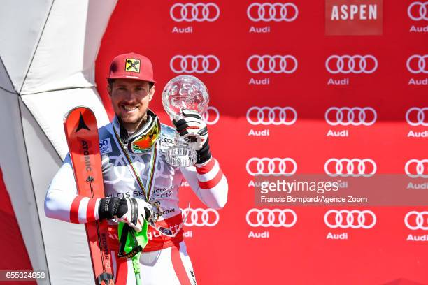 Marcel Hirscher of Austria wins the globe in the overall standings during the Audi FIS Alpine Ski World Cup Finals Women's Giant Slalom and Men's...