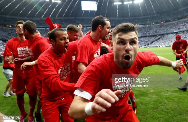Marcel Hofrath of Jahn Regensburg celebrates after the Second Bundesliga Playoff second leg match betweenTSV 1860 Muenchen and Jahn Regensburg at...