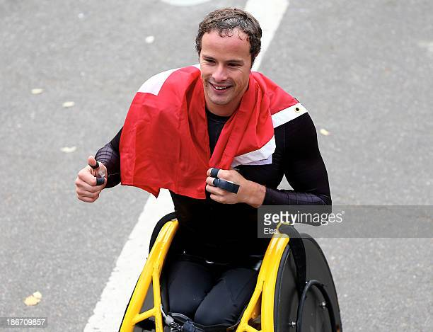 Marcel Hug of Switzerland celebrates after he won the Mens Wheelchair division of the 2013 ING New York City Marathon on November 3 2013 in New York...