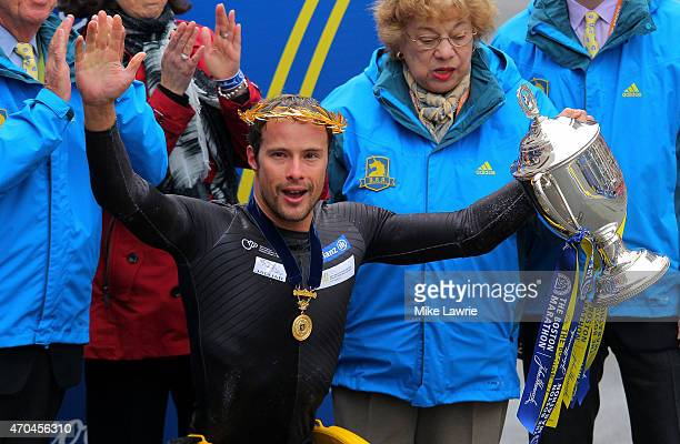 Marcel Hug of Switzerland celebrates after winning the men's push rim wheelchair division of the 119th Boston Marathon on April 20 2015 in Boston...