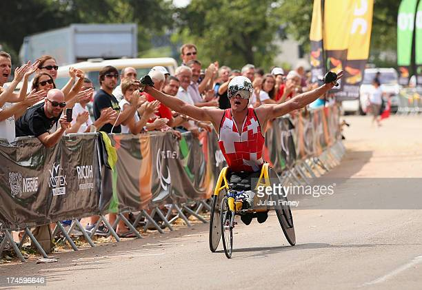 Marcel Hug of Switzerland celebrates winning in the Men's Marathon T54 during day nine of the IPC Athletics World Championships on July 28 2013 in...