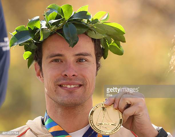 Marcel Hug of Switzerland celebrates with his medal after finishing first in the Professional Wheelchair Men's Division during the 2016 TCS New York...