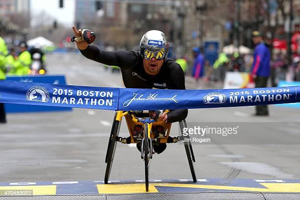 Marcel Hug of Switzerland crosses the finish line to win the men's push rim wheelchair division of the 119th Boston Marathon on April 20 2015 in...