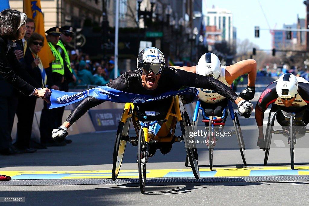 Marcel Hug of Switzerland crosses the finish line to win the men's push rim wheelchair race during the 120th Boston Marathon on April 18, 2016 in Boston, Massachusetts.