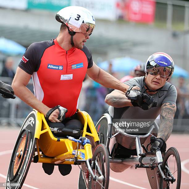 Marcel Hug of Switzerland shakes hands with David Weir of Great Britain after the 1500m race at the ParAthletics Grand Prix on May 30 2015 in Nottwil...