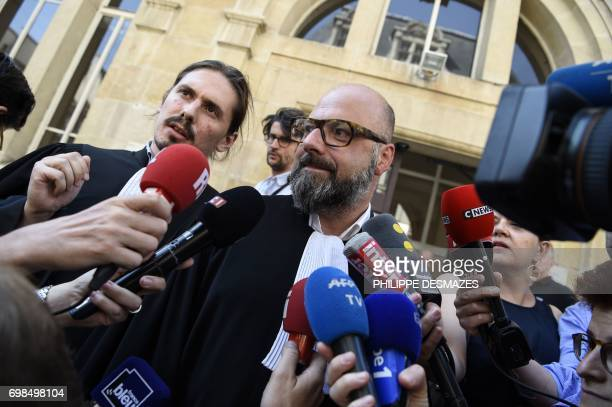 Marcel Jacob's lawyer Stephane Giuranna and Jacqueline Jacob's lawyer Gary Lagardette speak to journalists on June 20 prior to a hearing as part of...