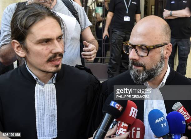 Marcel Jacob's lawyer Stephane Giuranna and Jacqueline Jacob's lawyer Gary Lagardette speak to journalists at Dijon's courthouse on June 20 prior to...