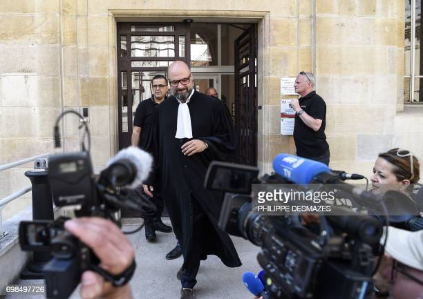 Marcel Jacob's lawyer Stephane Giuranna arrives to speak to journalists at Dijon's courthouse on June 20 prior to a hearing as part of the case of...