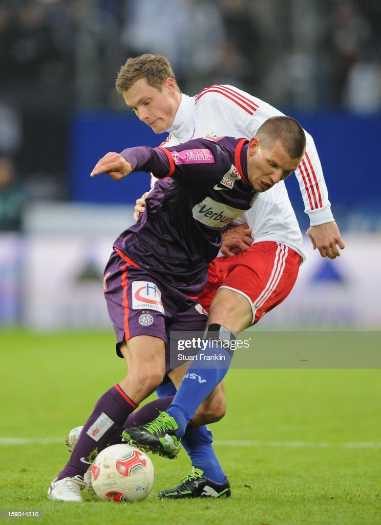 Marcel Jansen of Hamburg challenges for the ball with Alexander Gorgon of Vienna during the international friendly match between Hamburger SV and Austria Wien at Imtech Arena on January 12, 2013 in Hamburg, Germany.