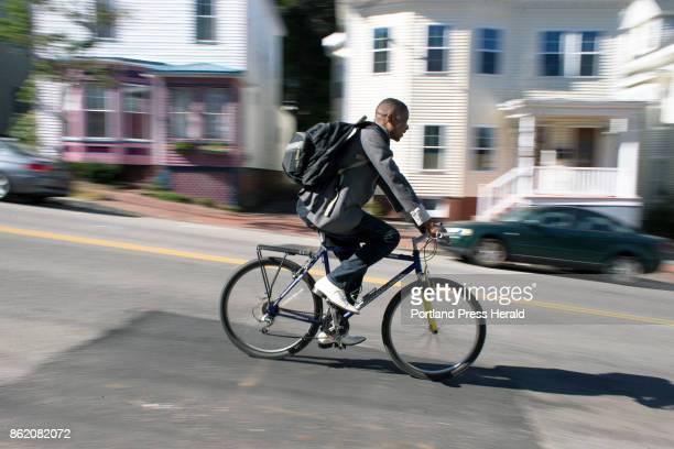 Marcel Kabongo Mafuku an asylee from the Congo coasts down Deering Avenue toward his Parkside apartment The bicycle is Kabongo Mafuku's main source...