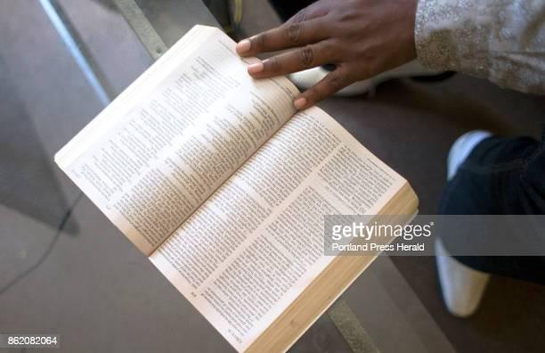 Marcel Kabongo Mafuku an asylee from the Congo flips through his Holy Bible an English edition that he reads every day he said Kabongo Mafuku is a...