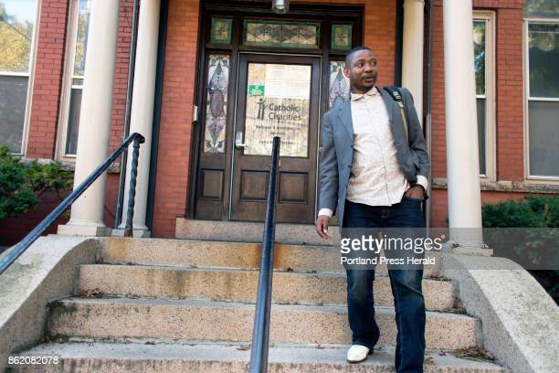 Marcel Kabongo Mafuku an asylee from the Congo leaves Catholic Charities' office in Parkside The organization's refugee and immigrant services have...