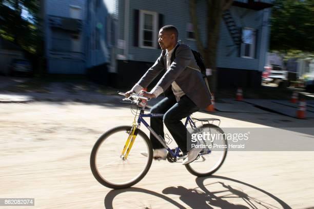 Marcel Kabongo Mafuku an asylee from the Congo rides through the Portland's Parkside neighborhood where he lives The bicycle is Kabongo Mafuku's main...