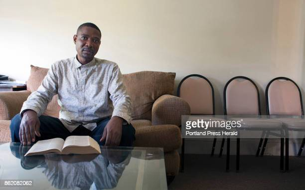 Marcel Kabongo Mafuku an asylee from the Congo sits in his living room in front of a Holy Bible that he reads every day he said Kabongo Mafuku...