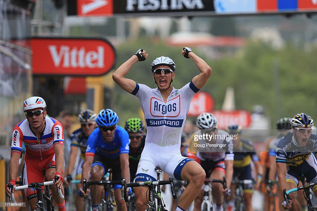 <a gi-track='captionPersonalityLinkClicked' href=/galleries/search?phrase=Marcel+Kittel&family=editorial&specificpeople=4520423 ng-click='$event.stopPropagation()'>Marcel Kittel</a> of Germany and Argos-Shimano celebrates after winning stage one of the 2013 Tour de France, a 213KM road stage from Porto-Vecchio to Bastia, on June 29, 2013 in Bastia, France.