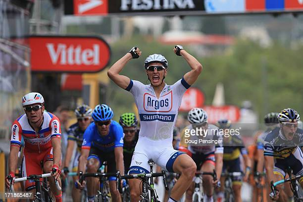 Marcel Kittel of Germany and ArgosShimano celebrates after winning stage one of the 2013 Tour de France a 213KM road stage from PortoVecchio to...