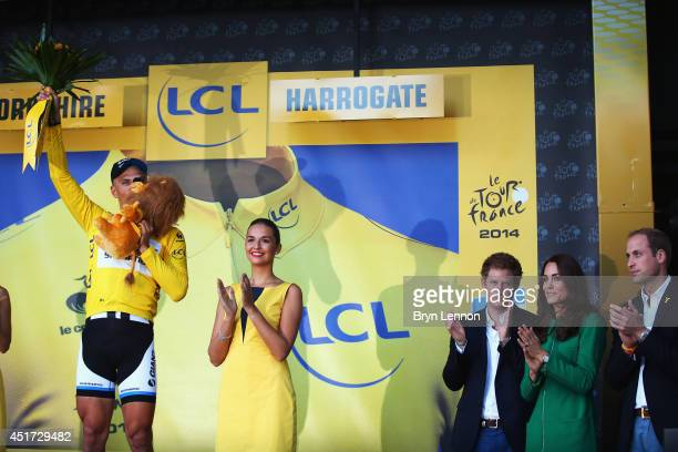 Marcel Kittel of Germany and Giant Shimano celebrates winning stage one as Prince Harry Catherine Duchess of Cambridge and William Duke of Cambridge...