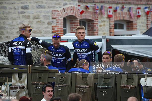 Marcel Kittel of Germany and leader of Etixx Quickstep arrives aboard a first world war military vehicle during the team presentations on June 30...