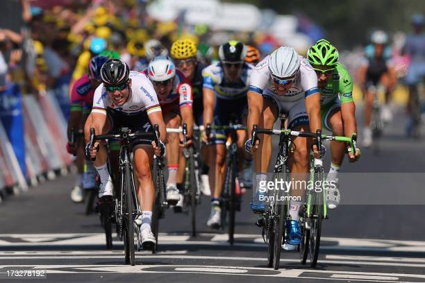Marcel Kittel of Germany and team ArgosShimano beats Mark Cavendish of Great Britain and Omega PharmaQuickstep to the finish line during stage twelve...