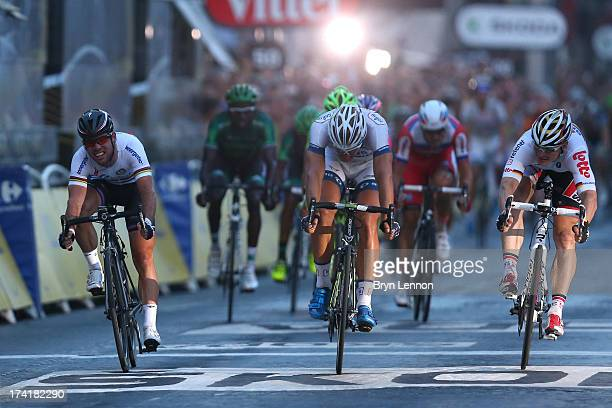 Marcel Kittel of Germany and Team ArgosShimano beats Mark Cavendish of Omega PharmaQuickstep and Andre Greipel of Lotto Belisol in the sprint during...