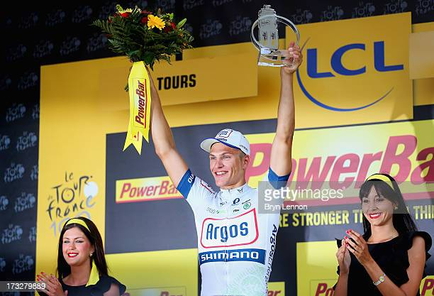 Marcel Kittel of Germany and team ArgosShimano celebrates on the podium after winning stage twelve of the 2013 Tour de France a 218KM road stage from...
