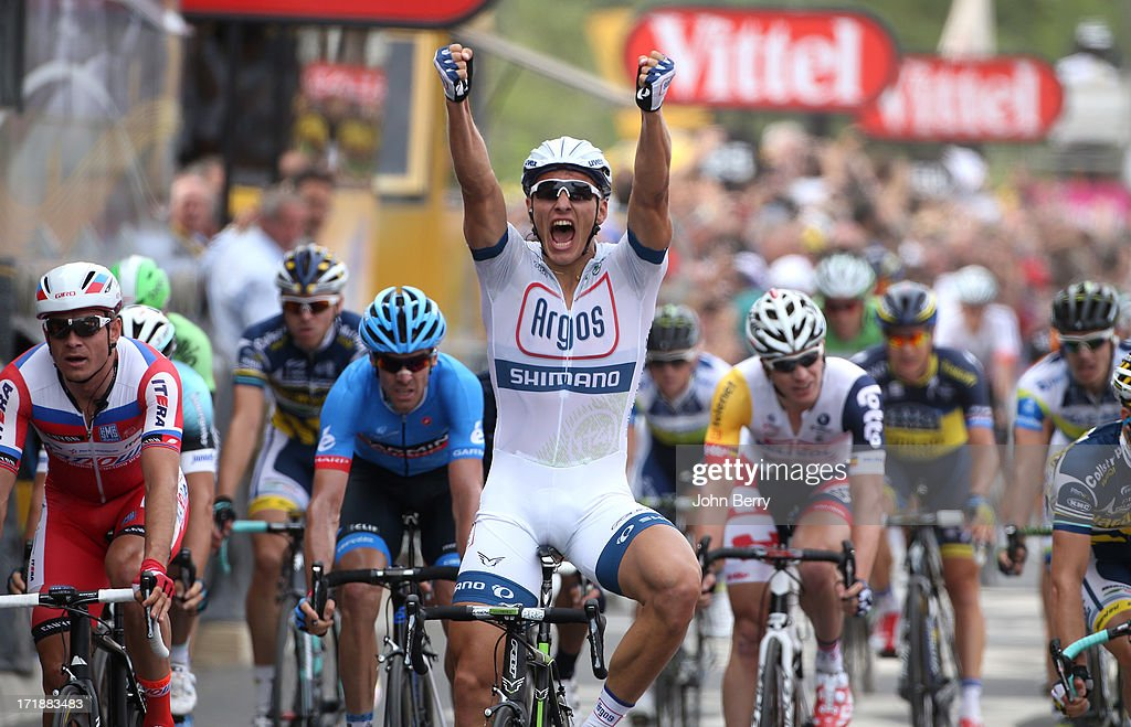 <a gi-track='captionPersonalityLinkClicked' href=/galleries/search?phrase=Marcel+Kittel&family=editorial&specificpeople=4520423 ng-click='$event.stopPropagation()'>Marcel Kittel</a> of Germany and Team Argos-Shimano wins Stage One and wears the first yellow jersey of the Tour de France 2013 on June 29, 2013 in Bastia, Corsica, France.